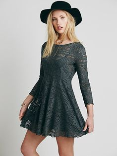 Spring Date Dress | Flirty fit and flare mini dress, with a rounded neck and three-quarter length sleeves, in a sheer crochet lace.  Includes a detachable slip.  Open in back with button closures.   *FP Beach   *FP Beach is a collection that embodies the free spirit of the seaside lifestyle with casual knit dressing, lightweight layers, and effortless shapes.