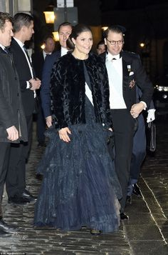 The Swedish royal family have tonight stepped out for a formal gathering of the Swedish Academy in Stockholm. Princess Sofia and Prince Carl Philip held hands as they waved to the public.
