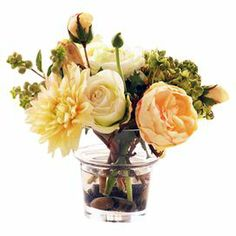 """Faux rose and ranunculus arrangement in a glass vase.  Product: Faux floral arrangementConstruction Material: Glass and fabricColor: Yellow, peach, and greenDimensions: 12"""" H x 9"""" W x 8"""" D"""