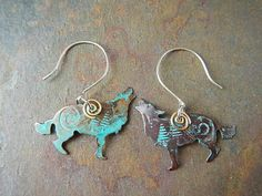 I could see renesmee wearing these Hey, I found this really awesome Etsy listing at https://www.etsy.com/listing/180087457/wolf-earrings-of-verdigris-copper