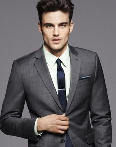 Charcoal suit. Navy tie and clip. Navy pocket square.