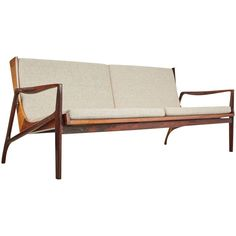Jacaranda Brazilian Modern Sofa Attributed to Joaquim Tenreiro, circa 1960 | From a unique collection of antique and modern sofas at https://www.1stdibs.com/furniture/seating/sofas/