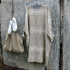 This dress is a limited edition! Made from a soft herringbone linen and based on one of our most popular shapes, its ideal for autumn and winter. Layer it for winter with boots and a chunky knit. One size fits most Measurements Bust 64 inches Length 40 inches Free Shipping within Australia International Shipping $14 USD
