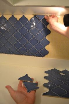 diy backsplash installation…LOVE THIS TILE! Think I would love it in a sea green or a turquoise blue better.  From Home Depot