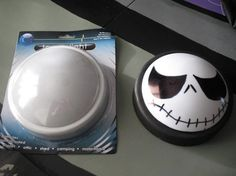 lighted face from dollar store push light--you could draw on any kind of face, make it an eye, Jack-o-lantern, etc.