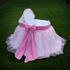 Nikki Bassinet - For your Baby Princess!  Made of 100% luxurious dupioni silk with a pink organza overlay, the pretty pink bow adds that perfect finishing touch. Place your order today.