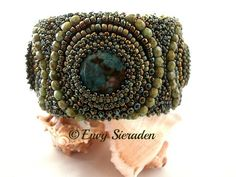 Cuff with a alluminium core.Materials used:3 green turquoise cabochons,miyuki and toho seedbeads in green colors,facetted beads in green piccasso colo