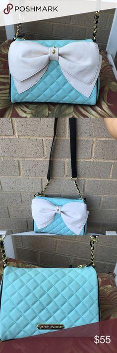 Betsey Johnson crossbody bag Very cute Betsey Johnson crossbody with big bow design . Top zipper closure . Inside has one zipper pocket and 2 slip pockets . Betsey Johnson Bags Crossbody Bags