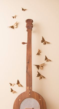 Love these bronze metallic paper butterflies for decorating the living room wall in my apartment, so pretty. :)