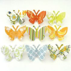 Attach cardstock butterflies to pushpins and mount inside shadowbox on cork board or styrofoam.