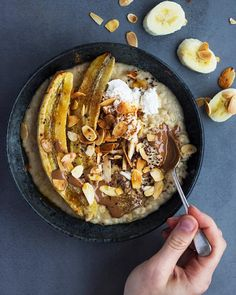 Cozying up with my friends blanket @_sho_homeland_  tahini porridge roasted banana almond butter  toasted almonds. by shanyaraleonie