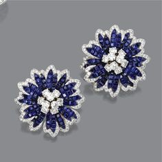 PAIR OF INVISIBLY-SET SAPPHIRE AND DIAMOND FLOWER EARCLIPS, ALETTO BROTHERS. The flowerheads set in the center with clusters of round diamonds, the flexibly-attached petals invisibly-set with square-cut sapphires and edged in small round diamonds, the total diamond weight approximately 6.60 carats, mounted in platinum and 18 karat gold, signed Aletto Bros. With signed leather case.