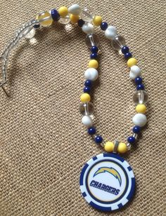 $25 Chargers Poker Chip Necklace - fun to wear - fun to give - we can do most teams- follow us on facebook Swirly Qs Jewelry www.swirlyqs.com www.etsy.com/shop/swirlyqs