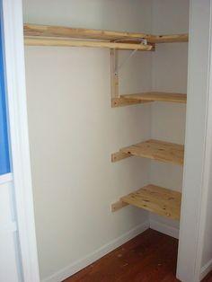 kids closet- love the shelves on the side