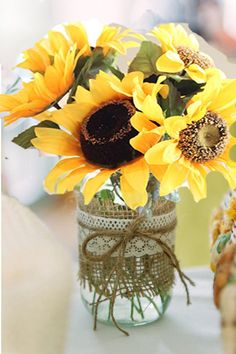 Sunflowers and Mason Jars remind me of my Mom.  I love her so.  Sunflowers are her favorite flower.  She also uses Mason Jars to keep flowers and things in too.
