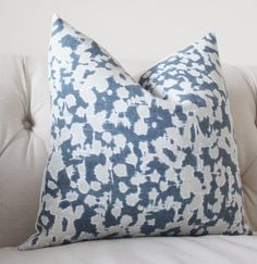 This is a Beautiful Pillow Cover in Rain Dance in Indigo by Schumacher. The Colors are Indigo Blue and Greige.