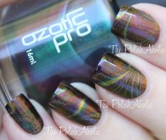 The PolishAholic: NOTD: Multichrome Water Marble - GORGEOUS! I want Ozotic polishes so bad. Too bad they're kinda expensive :P