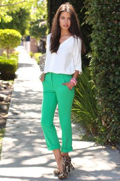 green pants, white shirt, blingy bag and leopard heels