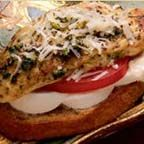 Pesto Chicken Bruschetta - Skillet-toasted slices of sourdough bread are topped with asiago and fresh mozzarella cheeses, tomato and pesto-cooked chicken breast sprinkled with more asiago cheese.