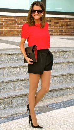 Bright orange top with black shorts