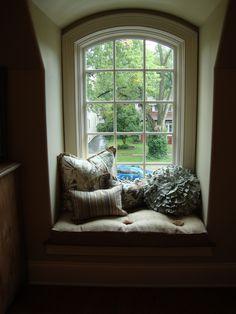 Quatrine silk burlap window seat cushion with pom poms