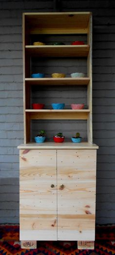 Kitchen cabinet - made from pallet wood by jasper & george, colourful ceramic bowls by Maureen Visage