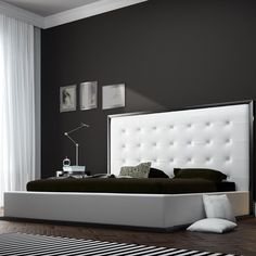 Features:  -Constructed from solid hardwood and MDF.  -Upholstered in bonded leather.  -Lavish button-tufted headboard stands five feet tall.  -Elegantly framed in a rich wenge border to match any dec