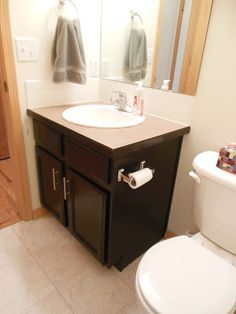 A very good tutorial with product recommendations for a gel stained vanity to restain and upgrade the traditional builders vanity in a bathroom - weekend bathroom projects with big impact - cheap ways to get your home ready to sell - gel stains done well