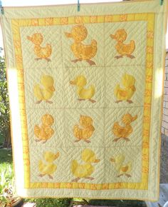Duck Quilt - Hand Appliqued, Machine pieced 20 years ago. The yellows in this quilt are simply deluxe, love the hues. Peace, Robert from nancysfabrics.com