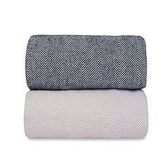 Perfect for snuggling with, Downtown Company Herringbone Blanket keeps you warm and cozy without the weight of a heavy blanket. The 100% long staple cotton blanket features a classic two-tone herringbone pattern for a stylish look.