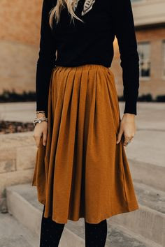 """Gold Mustard Skirt Gathered Elastic Waist Hidden Hip Pockets Pleated Detail Waist Band Offers 2-3"""" Stretch View Size Chart Model is 5'9"""" + Wearing a Small"""