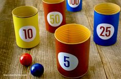 Keep the kids busy on a rainy day! Tin cans, printable scoring labels and ping-pong balls make an indoor toss game the whole family will enjoy.