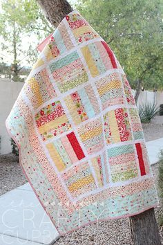 Jelly Roll Baby Quilt featuring Sweetest Thing designed by Zoe Pearn for Riley Blake Designs