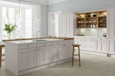 Classic kitchen with white doors and split worktop featuring modern lighting. CGI 2017, design and production by www.pikcells.com for Wren Kitchens