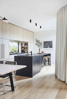The owners of this house transformed a former backpacker dwelling into their dream Scandi-noir family home. Kitchen Island Bench, Kitchen Benches, Kitchen Islands, Polished Concrete Flooring, Parquet Flooring, Timber Kitchen, Designer Bar Stools, Home Decor Kitchen, Kitchen Ideas