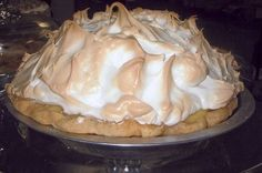 HOMEMADE LEMON MERINGUE PIE! 1 cup white sugar 2 tablespoons all-purpose flour 3 tablespoons cornstarch 1/4 teaspoon salt 1 1/2 cups water 2 lemons, juiced and zested 2 tablespoons butter 4 egg yolks, beaten 1 (9 inch) pie crust, baked 4 egg whites 6 tablespoons white sugar How to make it : Preheat oven to 350 degrees To Make Lemon Filling: In a medium saucepan, whisk together 1 cup sugar, flour, cornstarch, and salt. Stir in water, lemon juice and lemon zest. Cook over medium-high heat…