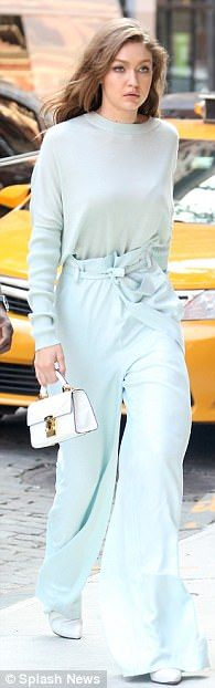 Chic: The 22-year-old IMG Model donned a baby-blue knit sweater with matching palazzo pant...
