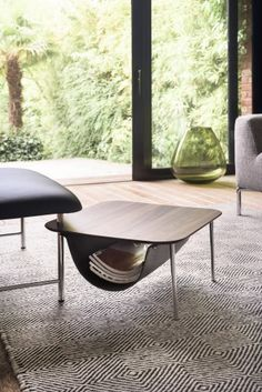 Gipsy | JORI - A footstool. A sofa. An extension to lay down when sitting. And a coffee table if you feel like it. This multifunctional footstool fits every JORI interior and is equipped with a practical fold-out table. For those who want there is a bag for extra storage available.