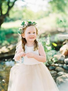 Flower girl wearing a organic flower crown: http://www.stylemepretty.com/texas-weddings/driftwood-texas/2016/08/25/modern-lush-austin-greenhouse-wedding/ Photography: Ashley Bosnick - http://www.ashleybosnick.com/