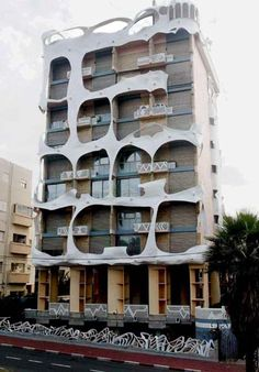 """#Gaudi-styled house, called """"The Crazy Building"""", located in Tel-Aviv. Designed by architect Leon Geneva in 1985 and is actually an apartments building with real families living there.  In this picture - the Crazy House facade."""