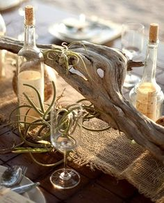 Driftwood table centerpiece: http://www.completely-coastal.com/2014/11/decorating-ideas-with-bottles.html