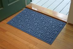 """Aqua Shield Stained Glass Mat Size: 2' x 3', Color: Medum Blue by Bungalow. $33.37. Color: Medium Blue. Drys Quickly. Size: .5""""H x 24""""W x 36""""D. Easy Maintenance. Stops Mud and Water at the Door. 707560023 Size: 2' x 3', Color: Medum Blue Features: -Surface material: Premium 24 oz. polypropylene.-Origin: USA.-Green friendly with over 20pct recycled rubber backing.-Low profile design allows most doors to glide easily over it.-Will not crush, fade, mold, mildew or rot.-Anti-static..."""