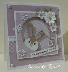 Handmade card by DT member Sigrid with Collectables Bunny (COL1354), Snowglobe (COL1362), Creatables Flower Set Fancy (CR1356), Flower Set Funky (CR1357), Flower Set Sweet (CR1358) and Punch Die Butterflies (LR0261) from Marianne Design