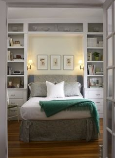 Built-in bookcase headboard in small bedroom gives elegant but cozy feel to the room.