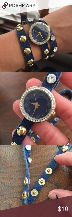 Stylish watch Blue faux leather multi strand watch. Features a blue face, gold numbers, rhinestones and gold studs. Three snap closure for an adjustable fit. Photo shown is of me using the smallest fit. Needs a new battery. I have poor vision, so I prefer a larger face. It's super cute though and can add a little bit of preppy sophistication to any outfit. Smoke and pet free home. Jewelry