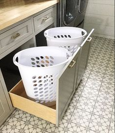 Laundry room laundry room storage hampers cement tile cement tile shop atlas II cement tile grey and white Benjamin Moore paint color cape may cobblestone storage solutions