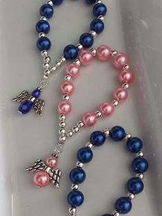 Handmade finger rosaries with angels made with glass pearl beads & silver plated beads in between. These finger rosaries are also perfect gift for someone special, also gift favors on Baptism occasions Length is around 4 long Beads size used: 8 mm & 4 mm To see more of my work