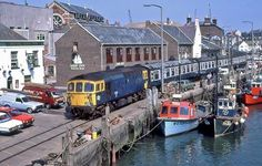 15 June 1984 the Up Channel Boat train winds it's way along the quay at Weymouth, this was during the period when it ran with a suitable headboard.