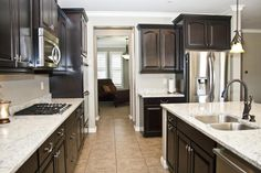 Appliances include a 5-burner cooktop, an upgraded Bosch dishwasher, and double ovens in stainless steel. www.teamwoodall.com/472honeybee