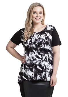 The mixed media digital print with contrasting black sleeve gives this tee a contemporary look. It looks great worn with a 'half-tuck' into your favourite jeans or a structured skirt and paired with heels and bold accessories | Women's Plus Size Fashion #plussize #fashion